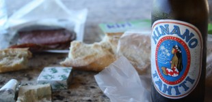 The lunch menu - salami, cheese, baguette, and a local beer